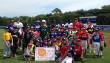 The pros and kids share a group photo after Sunday's clinic.