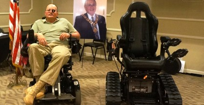 Navy Veteran Peter Reid, 54, and his new art track motorized wheelchair.
