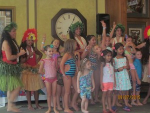 The Children of Saturnia with Hula Dancers