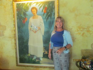 Nancy McCrossan of Cheeca Lodge staff wth Bess Truman portrait
