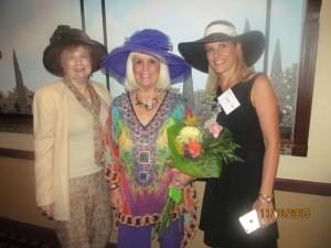 Evalyn David, Charlotte Beasley and Karen Turk we presented flowers to Helene