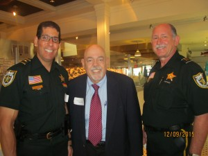 Tiger Bay Pres., Barry Epstein with two of PBSO's finest