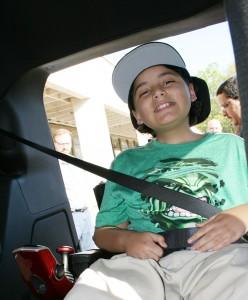 Damarius Roman is all smiles in his new wheelchair-accesssible van.