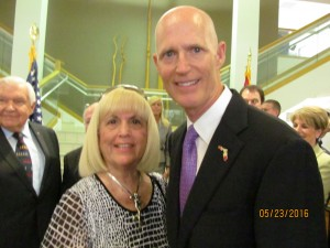 Charlotte Beasley and Gov. Rick Scott