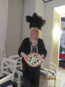 Black Hat Diva Leader, Charlotte Beasley with black hat cookies