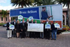 "On hand to celebrate Broken Sound Club's donation of its fourth and fifth homes to Habitat for Humanity of South Palm Beach County and the Club's kick-off of the Community ReStore Club Challenge initiative to ""stock up"" inventory at the nonprofit's home improvement center and thrift shop ReStores were (from left): Scott Sullivan, Gene Folden, Kari Oeltjen, Rick Howard, Eric Bucher, Robert Weinroth, Randy Nobles, John Crean, Eric Lebersfeld, Lee Edelstein, and Dr. Edmund J. Elkins."