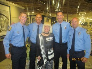Charlotte Beasley with members of Boca Fire Rescue