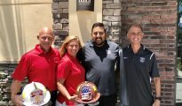 (From left) Brett Lea and Diane Lea of the Boca Raton Firefighter & Paramedic Benevolent Fund, Tilted Kilt Pub & Eatery Owner Samir Changela, Tom Vladimir of the Boca Raton Police Athletic League.