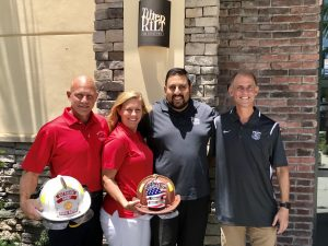 (From left) Brett Lea and Diane Lea of the Boca Raton Firefighter & Paramedic Benevolent Fund, Tilted Kilt Pub & Eatery Owner Samir Changela, Tom Vladimir of the Boca Raton Police Athletic League.