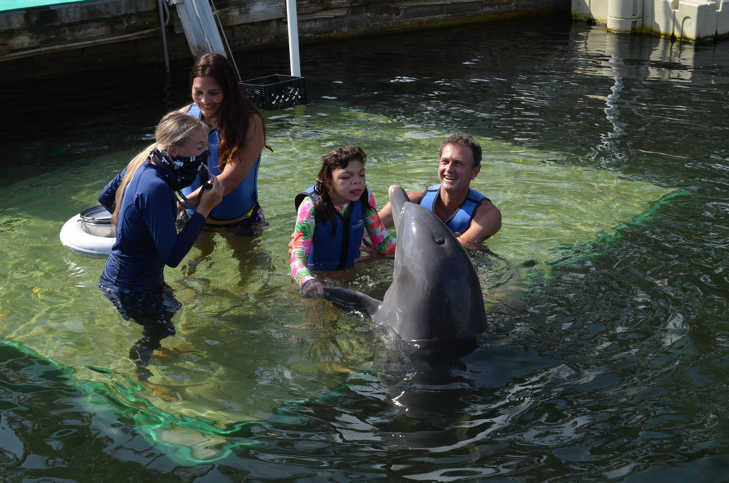 Boca girl's dream to swim with dolphins comes true, thanks to Make-A-Wish